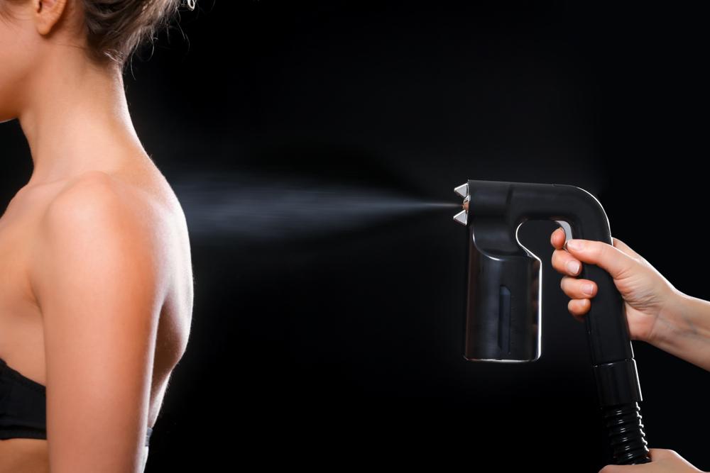 girl getting spray tan